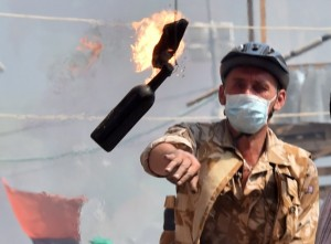 A man throws a Molotov cocktail in Kiev. (Photo by Sergei Supinsky/AFP/Getty Images)