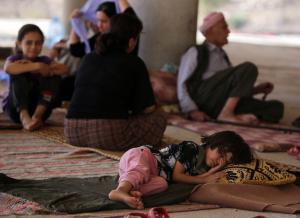 A child sleeps as Iraqi Yazidis take refuge in Dohuk. (Photo by Ahmad Al-Rubaye/AFP/Getty Images)